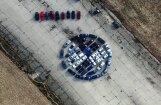 Video: Arī BMW fani Rumbulā metas logo veidošanas trakumā