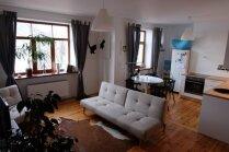 От разрухи до шедевра: стильно отремонтированная квартира-студия в Риге