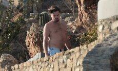 Paparaci foto: Leonardo Dikaprio izrāda torsu