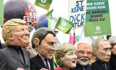 Foto: Hamburgā ielās un ūdenī tūkstoši protestē pret gaidāmo G20 samitu