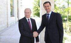 Foto: Sočos notikusi Putina un Asada tikšanās