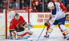 Calgary Flames goalie Chad Johnson, Buffalo Sabres Zemgus Girgensons scores goal