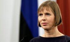 ФОТО: Президента Эстонии нарисовали голой и с татуировками