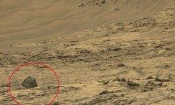 Uz Marsa saskatīts kases aparāts