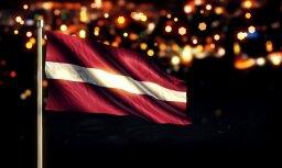 Австрийцы справили в Вецриге нужду, украли флаг Латвии и ходили с ним по городу