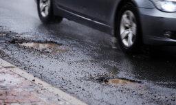 На дорогах Латвии завершен массовый ремонт ям