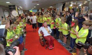 ФОТО: Латвийские паралимпийцы вернулись на родину