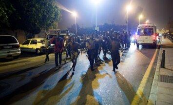 Video: Seutā ielaužas gandrīz 200 nelegālie migranti