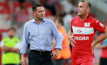 head coach Dmitry Alenichev, left, and player Denis Glushakov