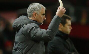 MU manager Jose Mourinho holds a banana