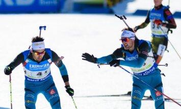 France Simon Desthieux touches his teammate Martin Fourcade