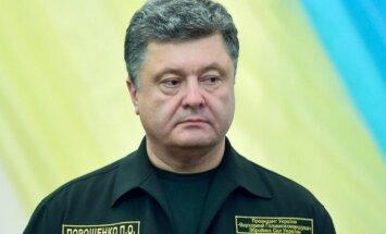 Saasinoties situācijai Donbasā, Porošenko pārtrauc vizīti Vācijā