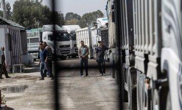 Kravas mašīnā uz Lietuvas un Baltkrievijas robežas atrasti 14 pārsaluši nelegālie imigranti