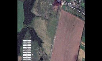 Video: Skats uz MH17 nokrišanas vietu Ukrainā no gaisa
