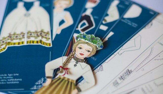 Latvijas simtgadei par godu tapusi papīra leļļu kolekcija tautas tērpos