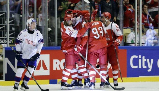 Дания взяла 3 очка и обошла в таблице Латвию, американцы забросили корейцам 13 шайб