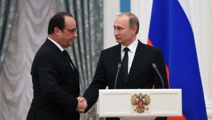 МИД Франции: Олланд и Путин обсуждали вопрос снятия санкций с России