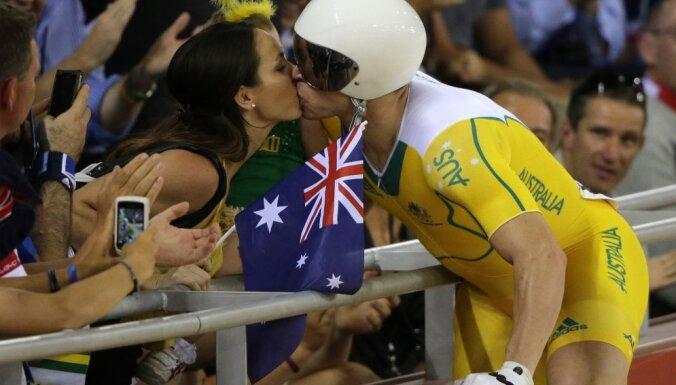 Australia Shane Perkins kisses his wife