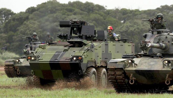 Ķīna vērsīs sankcijas pret ASV uzņēmumiem, kas piegādās ieročus Taivānai