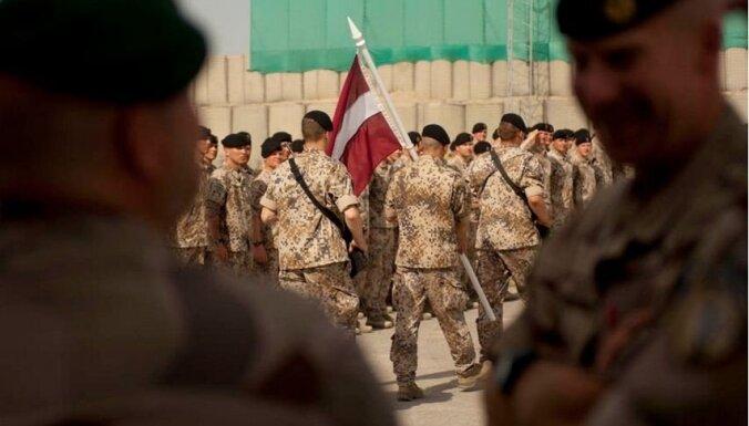 Латвия думает увеличить число своих военных в операциях в Афганистане и Ираке