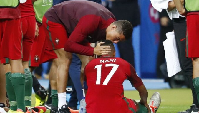 Portugal s Cristiano Ronaldo speaks to Nani