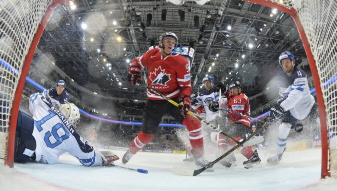 Connor McDavid of Canada scores a goal past goalkeeper Mikko Koskinen of Finland
