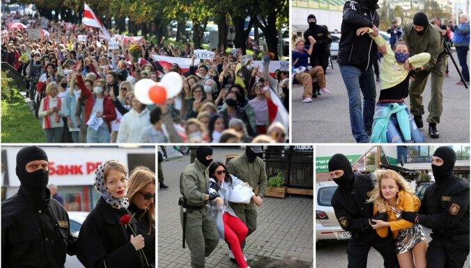 Foto: Minskā gājienā godina nacionālā karoga dienu; OMON aiztur dalībnieces