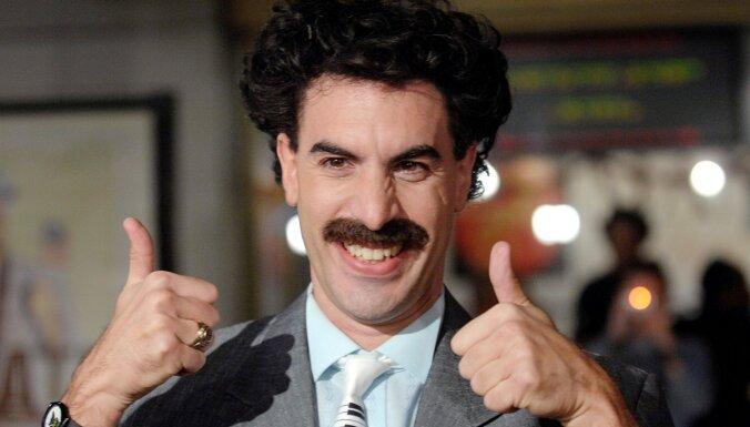 Koens sūdz tiesā marihuānas veikalu par Borata tēlu tā reklāmā
