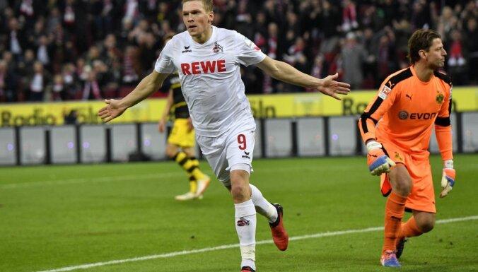Cologne Artjoms Rudnevs, Dortmund goalkeeper Roman Weidenfeller