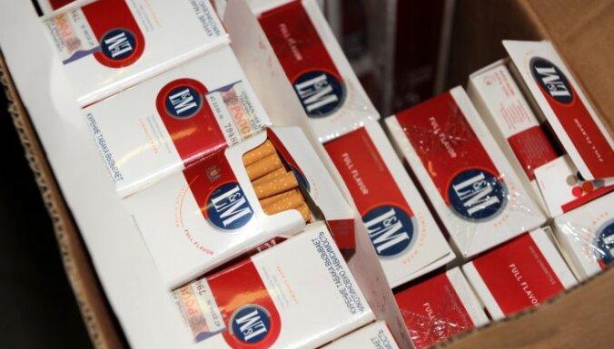 Сигаретные контрабандисты ежегодно крадут у Латвии десятки миллионов