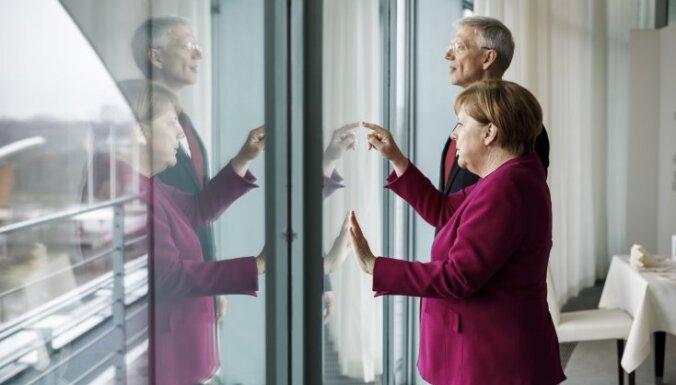 ФОТО: Кариньш в Берлине встретился с Меркель