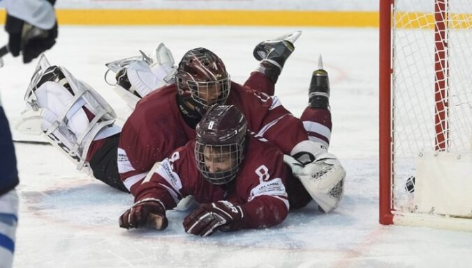 Latvia U-18 Janis Voris #1 and Andrejs Kostjuks