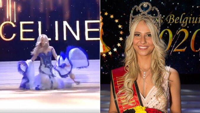 Video: Daiļā 'Mis Beļģija' skaistumkonkursā uz skatuves piedzīvo neveiklu ķibeli
