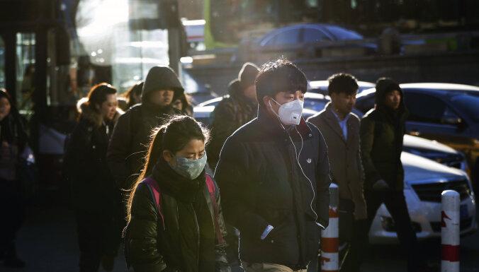 Pekina nosaka stingrus karantīnas pasākumus, gaidot cilvēkus atgriežamies no ķīniešu Jaungada brīvdienām