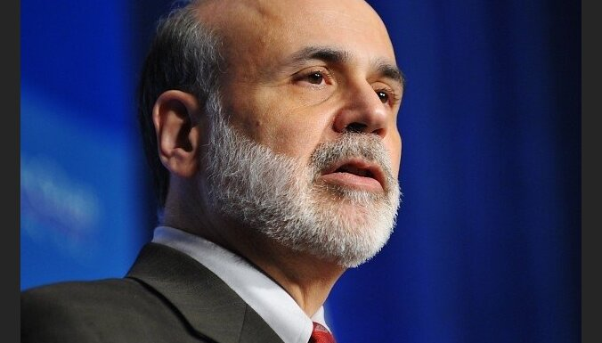 "Federal Reserve Chairman Ben Bernanke addresses the Economic Club of Washington December 7, 2009 at a hotel in Washington, DC. The US recovery from deep recession has ""some way to go"" before it becomes rooted enough to be ""self-sustaining,"" Bernanke said"
