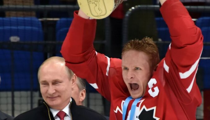 Canada forward Corey Perry celebrates with Russian President Vladimir Putin