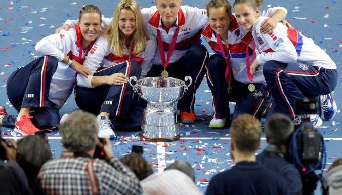 Czech Republic s Fed Cup team celebrate