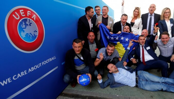 Members of the Kosovo media team celebrate