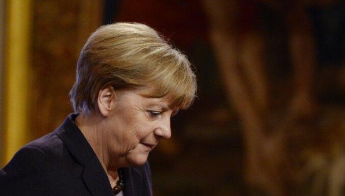 Guardian: новая коалиция Меркель и мигранты раскололи ЕС