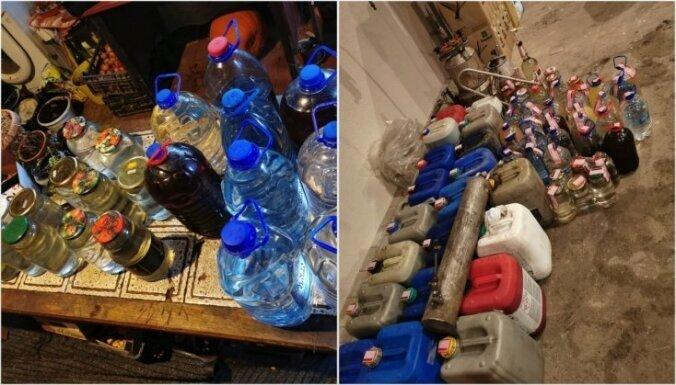 ФОТО. Полиция накрыла нелегальное производство алкоголя, изъято топливо и патроны