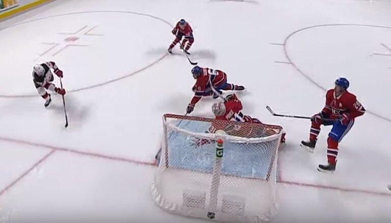 Video: NHL dārgākais vārtsargs Praiss lēcienā tver bīstamu metienu