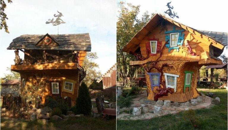 Foto: Lietuvā tētis saviem bērniem uzmeistarojis satriecošu raganas mājiņu