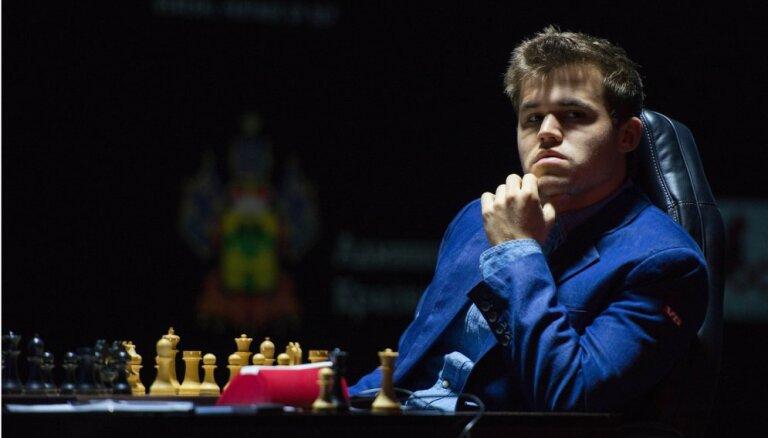 Норвежец Карлсен защитил в Сочи титул шахматного короля