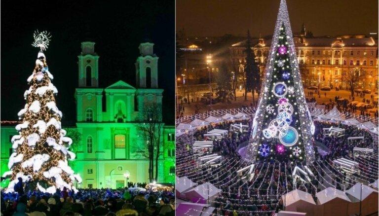 Egļu 'kari' Lietuvā: Viļņa un Kauņa sacenšas par smukāko svētku kociņu