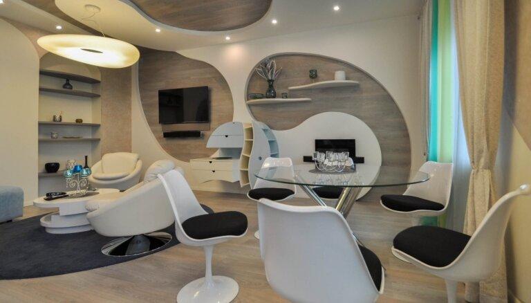 Foto: Rīgas centra pērle – dzīvoklis, kura interjers atgādina kosmosa kuģi