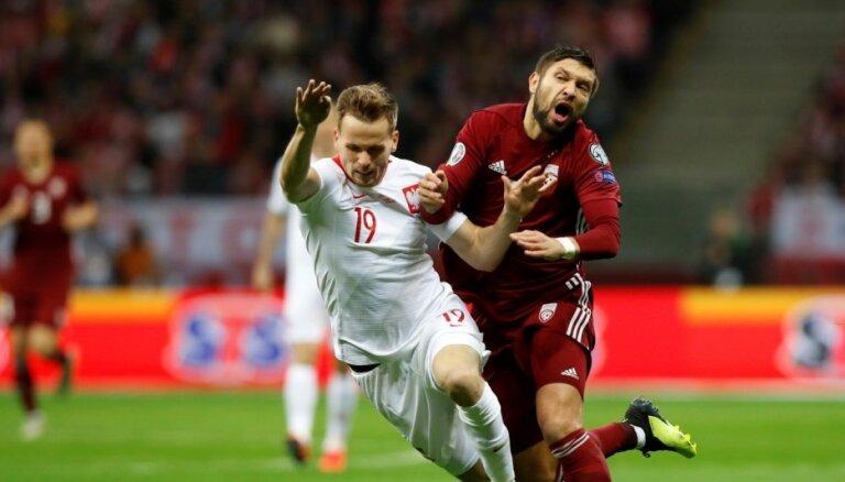 Latvijas izlasi no zaudējuma Polijā neglābj cienījams sniegums