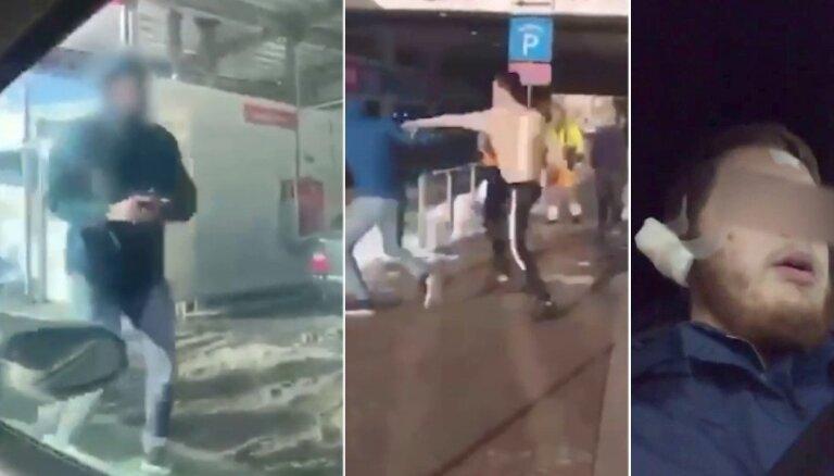 Video: Mūkusalas ielā automazgātavā apšaudē cietis vīrietis