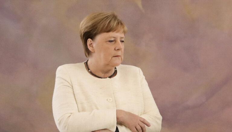Merkele mēģina glābt Lašetu pirms Bundestāga vēlēšanām