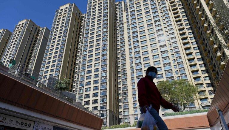 Ķīnā Covid-19 uzliesmojums; pandēmija pasaulē turpināsies arī nākamgad, prognozē PVO