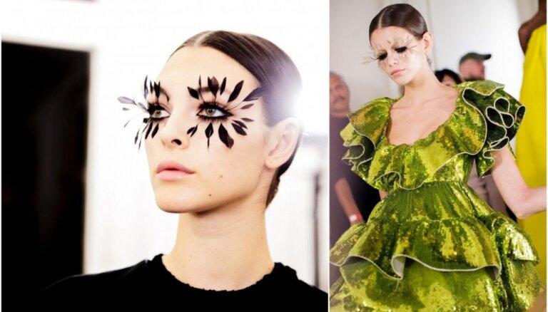 Skaistuma fantāzija modes skatē: izteiksmīgas spalvas un sejas zīmējumi